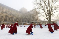 Dec. 11, 2013. The boys of Winchester Cathedral Choir enjoy a misty morning skate on the cathedral's ice rink which will be open until January 5th, in England.
