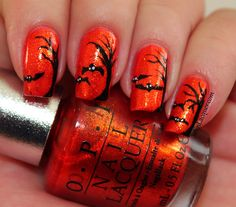 Halloween nail art with spooky trees and bats