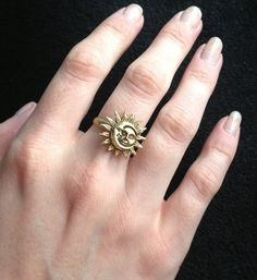 Gold Sun and Moon ring from LotusFairy. Saved to Things I want as gifts. Shop more products from LotusFairy on Wanelo. Keep Jewelry, Cute Jewelry, Silver Jewelry, Jewelry Accessories, Sun And Moon Rings, Ring Designs, At Least, Tattoos, Gemstones