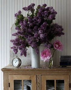 Lilacs from your backyard and a few peonies. All you need are a few blooms from your grocery store,farmers' market or backyard, a simple container—perhaps one found at a garage sale or in your recycling bin or kitchen cabinet—and a touch of whimsy to pull it all together! - In Flowers Chic and Cheap, Elle Decor editor at large Carlos Mota