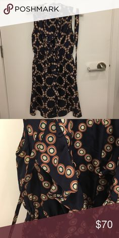 Silk dress from Anthropologie This dress is 100% silk in navy with a unique pattern throughout. It has ruffles down the middle and can be buttoned all the way up or left open. It comes with a matching belt to cinch the waist if desired. The waist is elastic so is naturally form fitting. Falls just above the knee. Anthropologie Dresses
