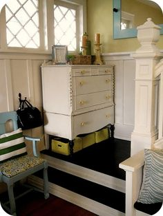 dresser at the bottom of the stairs via The Modern Cottage