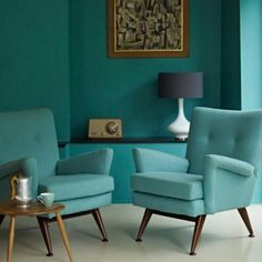 Love the use of teal in this mid century room!