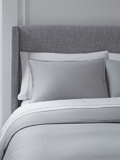 An understated elegance is presented in this geometric motif on sateen jacquard. With a nod to the American tradition of quilting, yet thoroughly modernized in neutral tones of silver, Minello easily works as a top-of-bed option or as an accent to your all-white bedding.