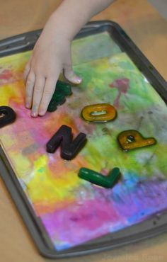 Painting with alphabet ice paints- a fun activity for Summer that sneaks learning into play.  The paints are really easy to make, too! Repinned by Apraxia Kids Learning. Come join us on Facebook at Apraxia Kids Learning Activities and Support- Parent Led Group.