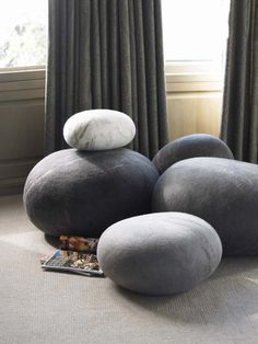 I love love love these!  soft pillows that look like pebbles?!? That's my kind of fun!    Interesting Design: Felt Pebble Cushions | InteriorHolic.com