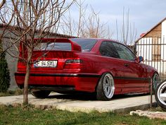 Calypsorot BMW e36 coupé on cult classic OZ AC Schnitzer type 1 wheels