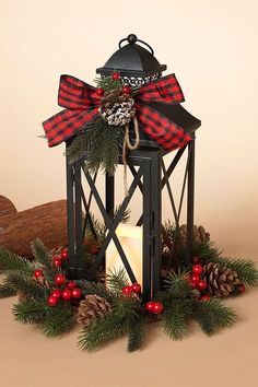 Decoração natalina The Buffalo Check LED Lighted Candle Lantern makes a fashionable holiday statement. Lantern has faux pine greenery, a plaid bow, and a built-in LED candle. Lantern Centerpieces, Lanterns Decor, Christmas Centerpieces, Candle Lanterns, Xmas Decorations, Candles, Homemade Decorations, Decorating With Lanterns, Christmas Lanterns Diy