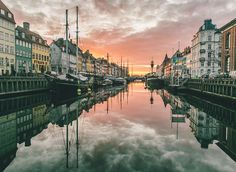 8 Must See Places in Scandinavia- Nyhavn Copenhagen, Denmark Canal River waterway cityscape water scene landmark City Town morning channel evening bridge cloudy line day