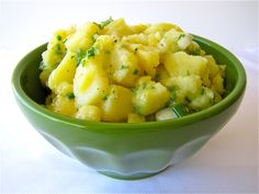 German Potato Salad (no bacon, mayo, eggs) - Ingredients: 2 pounds Yukon gold potatoes 2 tablespoons canola oil 2 tablespoons apple cider vinegar 1 tablespoon white vinegar 1/4 - 1/3 cup hot vegetable broth (water with a vegetable bullion cube dissolved)  1/2 medium onion, chopped 1 tablespoon brown deli mustard Salt and Pepper to taste 2 tablespoons parsley, minced 2 tablespoons chives, finely chopped