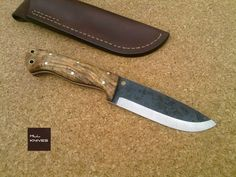 "AMAZON  Specifications:  STYLE: Amazon Scandi. STEEL: O1 carbon Steel. BLADE LOOK: Dark Forged. HANDLE: Olive Wood Burl, Black/Red liner, Full Tang Construction. HARDWARE: Brass. SHEATH: Bushcraft Brown Leather Sheath.  (230mm) 9"" OAL. (120mm) 4.7"" from handle to tip. (4mm) 0,15"" thick.  Price: 165.00 euros"