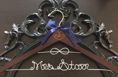 A personal favorite from my Etsy shop https://www.etsy.com/listing/234517615/infinity-knot-wedding-hanger-bridal