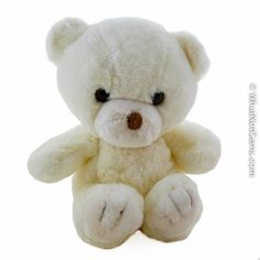 This incredibly soft white teddy bear has black eyes and a brown nose. Sits 9 inches tall and 9 inches wide across the arms. The condition of this bear is like new with the tag attached. (Slight wear on tag or not fully printed) This adorable teddy bear has been stored in a smoke-free home.Circa 1980s/$12.95
