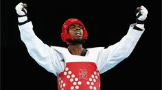 Lutalo Muhammad of Great Britain celebrates winning the bronze medal in the men's -80kg Taekwondo bronze medal finals bout against Arman Yeremyan of Armenia on Day 14 of the London 2012 Olympic Games at ExCeL