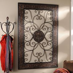 Add elegance to any wall with our Embossed Scroll Plaque! This metal wall plaque is the perfect piece for any bare wall with its dark brown finish and decorative accents.