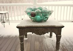 new love...must find these at an antique store...glass japanese fishing float balls