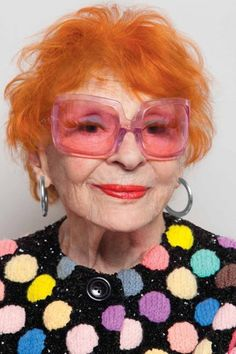 Orange hair, bright lips, and sunnies to match!