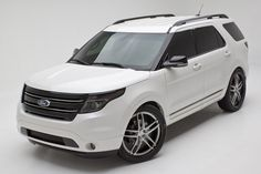 2012 Ford Explorer Limited by DSO Eyewear:    Exterior  BASF Pearl Tri Coat White, finished in Glasurite 90 line custom finishes;   L Interprises applied custom paint and black chrome details;  AAC Lighting custom LED headlight installation;   PIAA Tera LED Evolution lighting;  PIAA Forenza wiper blades;  T-Rex Custom wire crimped lower grille;  Tinted Window in Amber Chrome by Protective Film Solutions;  Stars Shield Armor the ultimate in clear bra protection