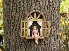 This miniature widow with little sitting girl will be a lovely addition to your fairy garden or miniature garden. It can be hung from a tree stump or be free standing. Made of resin. I have added a rustic screen mesh to the window and a tiny bird for an added touch of whimsy. Both are added using a weatherproof glue so this miniature is suitable for both indoor and outdoor use. Comes with the hanger on the reverse side for easy hanging. The girl is glued to the window ledge and can not be…