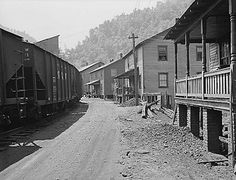 "Another picture of the Southern Coal Corporation company town at Bradshaw, McDowell County, WV. Did these people ever get used to living that close to the train? In the summer, with the windows open, the screeching wheels, rattling couplings, and horns would have been constant sounds coming right into the house. (1940's image from ""A Medical Survey of the Bituminous Coal Industry"" via the National Archives)"
