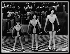 """Judy Garland (nee Frances Gumm) with her older sisters in their vaudeville act, """"The Gumm Sisters."""""""
