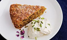 Spiced carrot, pistachio and almond cake with rosewater cream. Photograph: Liz & Max Haarala Hamilton