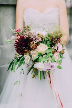 romantic winter bouquet - photo by Purple Tree Photography http://ruffledblog.com/romantic-elegance-at-spadina-museum  #wedding #weddings #bride #groom #dress #cake #bouquet   www.hotchocolates.co.uk www.blog.hotchocolates.co.uk www.evententertainmenthire.co.uk