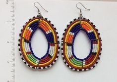 These+earrings+are+handmade+by+Masai+craftswomen+in+Kajiado+County,+Kenya.+This+traditional+design+is+timeless,+so+they+complement+your+casual+and+formal+looks+beautifully.+These+two+disc+earrings+measure+about+3+inches+long,+and+are+the+perfect+size+if+you+have+long+hair+or+simply+like+statement...
