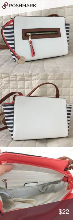 """FINAL 🚨 NWOT Call It Spring Small Crossbody Bag This is a very cute brand new crossbody! It is faux leather with rose gold metal accents and navy and white striped sides. There is a small scratch on the inside edge as pictured. Price is firm unless bundled. Bundle 2+ of my items and save 15%! I do not trade or hold items. The length is 9"""", width is 3"""", and height is 6.5"""". The bags strap is adjustable from 12.5"""" to 25"""". Call It Spring Bags Crossbody Bags"""