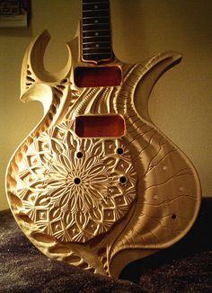 carved-guitar-vankuilenburg-2.jpg 550×761 pixels
