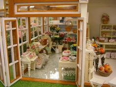 I love this miniature shop! I see some sweets, but more flowers and pumpkins, so I'm putting it in the florist and garden shop section.