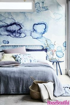 Inky blue interiors: An oversized inkblot wallpaper mural creates a dreamy atmosphere in a modern bedroom. For more ideas on how to decorate using a mix of glorious blues, visit housebeautiful.co.uk. (Styling by Sally Denning and Photography by Mark Scott).