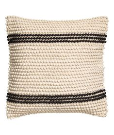 Natural white/black striped. Cushion cover in woven cotton fabric. Textured-weave front section with stripes made from jersey yarn. Solid-color back section