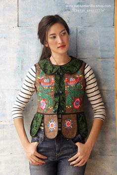 batik amarillis's piccola vest /jacket Piccola jacket in lovely   woven vest with  multi colored Hungarian folk embroidery meets tenun batik  gedog Tuban,Indonesia Take a fresh, sweet & whimsical approach to power dressing with this Krakow-Poland classic traditional folklore inspired jacket.  The beauty essential is reworked with a contrast-coloured batiks,unique cuttings ,trims,glossy beaded buttons,it has fitted waist with unique peplum petals