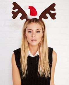 <p>Spark up some holiday cheer with this festive and fun reindeer antler headband! The antlers and bendable band are covered in a soft felt fabric with a sparkling mini Santa hat trimmed with fluffy feathers at the center. It's the perfect accessory for all of your upcoming holiday get togethers!</p>  <ul> 	<li>Man Made Materials</li> 	<li>Imported</li> </ul>