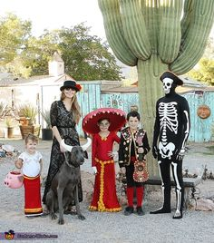 Liz: We do a family theme each year and this year my daughter chose Book of Life. The children are Maria, Manolo and La Muerte. Our dog obliged as el Toro...