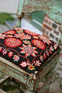 Russian pillow on a minty green patinaed chair