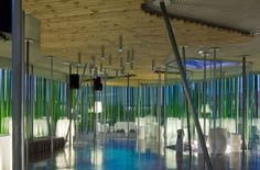 This MS Lounge is in Navarra, Spain that has a distinctive look. Designed by architects Vaillo + Irigaray, the cool structure allows guests to feel like they are dining and dancing within a bamboo forest. The verdant tubes that encase the lounge are made of recycled plastic, and to add even more green appeal, one wall of the building is partially lined with real shrubbery. A portion of the floor has been covered with a carpet of crushed green wine bottles (interior view 1).