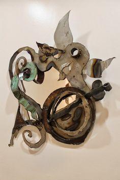 Fiddlehead Steel Mirror by Carol Kajorinne of Pike Lake Forge.