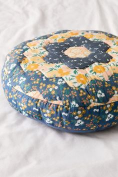 Ames Patchwork Round Throw Pillow | Urban Outfitters