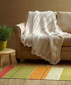 Ravelry: Lacy Throw #L0216AD pattern by Lion Brand Yarn