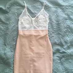 Pencil skirt dress with mesh & embroidered top. White and pale peach pencil skirt style dress. Has a mesh top with embroidery on bust. Worn once. Very flattering & sexy but yet feminine! Love this dress! Missguided Dresses Midi