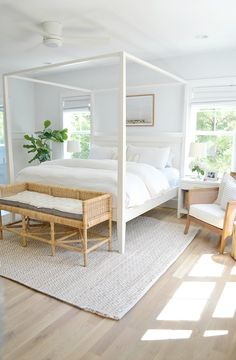 modern coastal bedroom decor with modern four poster bed and white bedding, neutral bedroom with jute rug and white walls, all white bedroom decor, cottage bedroom decor Coastal Bedroom Decorating, White Master Bedroom, Bright Homes, All White Bedroom, Bedroom Decor, Minimalist Bedroom, Coastal Master Bedroom, White Wall Bedroom, Home Bedroom