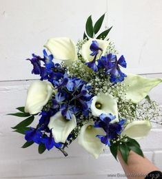Bridesmaid hand-tied bouquet featuring White calla lillies, blue delphinium and gypsy grass Wedding Flowers Liverpool, Merseyside, Bridal Florist, Booker Flowers and Gifts, Booker Weddings