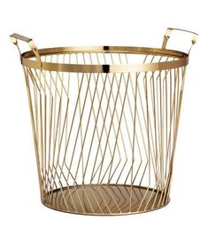 $24.99 Large metal wire basket with two handles at top. Height 9 1/2 in., diameter 10 1/2 in.