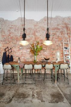 Find and explore exposed brick interior wall ideas for your apartment on Domino. Domino shares examples of exposed brick interior walls done right. House Design, House Styles, Industrial Dining, House Interior, Industrial Interiors, Brick, Brick Interior, Concrete Floors, Interior And Exterior