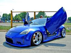 Sharp looking custom Nissan 350z with amazing lambo doors, ground effects, and those rims are super nice!