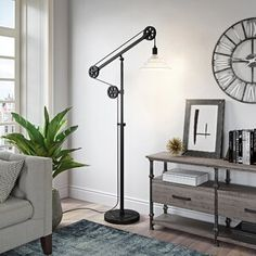Shop for Carbon Loft Tirith Floor Lamp in Blackened Bronze Finish with Pulley System and Ribbed Glass Shade. Get free delivery On EVERYTHING* Overstock - Your Online Lamps & Lamp Shades Store! Swing Arm Floor Lamp, Led Floor Lamp, Bronze Floor Lamp, Unique Lamps, Floor Finishes, Carlisle, Bronze Finish, Desk Lamp, Room Lamp