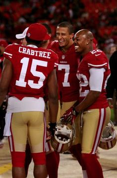 Colin Kaepernick shares a light moment with Michael Crabtree and Carlos Rogers.