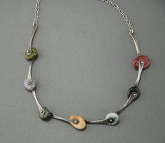 Little Ocean Jasper pebbles are linked together with bars of forged sterling silver. They are held in place with little heat-formed rivets, the overall